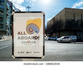 LISBON, PORTUGAL - FEB 8, 2018: All abroad message for the Eurovision Song Contest 2018 in Lisbon as seen in on the outdoor ooh banner advertising jcdecaux central lisbon street with cars