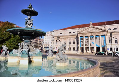LISBON, PORTUGAL - FEBRUARY 14: National theatre building and fountain sculptures on Rossio square, Lisbon on February 14, 2019.