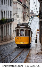 Lisbon, Portugal - February 16, 2010: The 28 tram in a street of the Chiado neighborhood in the city of Lisbon, Portugal;