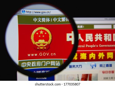LISBON, PORTUGAL - FEBRUARY 17, 2014: Photo of the Government of China homepage on a monitor screen through a magnifying glass.