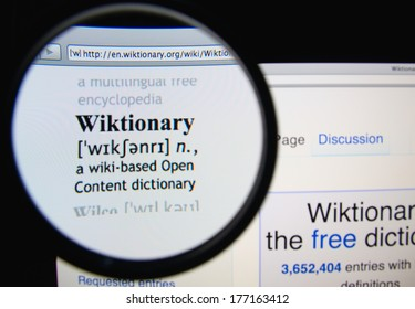 LISBON, PORTUGAL - FEBRUARY 17, 2014: Wiktionary homepage through a magnifying glass. Wiktionary is a multilingual, web-based project to create a free content dictionary of all words in all languages.