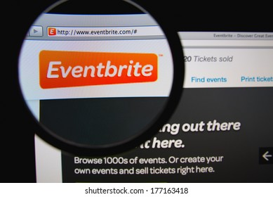 LISBON, PORTUGAL - FEBRUARY 17, 2014: Eventbrite homepage through a magnifying glass. Eventbrite is an online service that allows event organizers to plan, set up ticket sales and promote events.