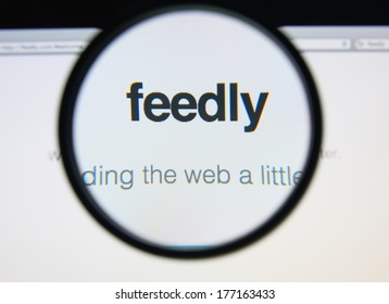 LISBON, PORTUGAL - FEBRUARY 17, 2014: Feedly homepage through a magnifying glass. Feedly is a news aggregator application for various Web browsers and mobile devices running iOS and Android.