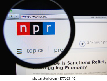 LISBON, PORTUGAL - FEBRUARY 17, 2014: Photo of the National Public Radio homepage on a monitor screen through a magnifying glass. NPR produces and distributes news and cultural programming.