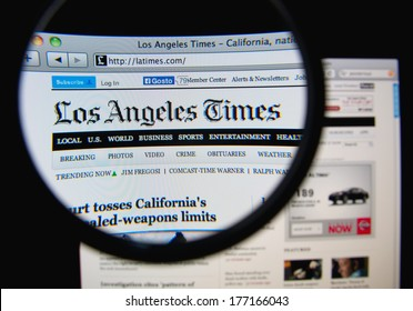 LISBON, PORTUGAL - FEBRUARY 17, 2014: Photo of the Los Angeles Times homepage on a monitor screen through a magnifying glass. The Los Angeles Times is a daily newspaper published in Los Angeles.