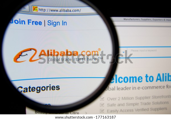 LISBON, PORTUGAL - FEBRUARY 17, 2014: Alibaba homepage on a monitor screen through a magnifying glass. Alibaba Group is a privately owned Hangzhou-based group of Internet-based e-commerce businesses.