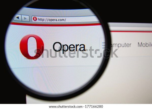 LISBON, PORTUGAL - FEBRUARY 17, 2014: Photo of Opera homepage on a monitor screen through a magnifying glass. Opera is a web browser developed by Opera Software.