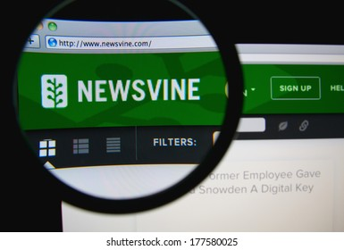 LISBON, PORTUGAL - FEBRUARY 19, 2014: Photo of Newsvine homepage on a monitor screen through a magnifying glass. Newsvine is a community-powered, collaborative journalism news website.