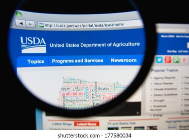 LISBON, PORTUGAL - FEBRUARY 19, 2014: Photo of the United States Department of Agriculture (USDA) homepage on a monitor screen through a magnifying glass.
