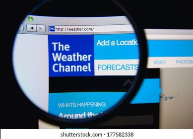 LISBON, PORTUGAL - FEBRUARY 19, 2014: The Weather Channel homepage on a monitor screen through a magnifying glass. The Weather Channel is an American basic cable and satellite television channel.