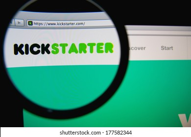 LISBON, PORTUGAL - FEBRUARY 19, 2014: Kickstarter homepage through a magnifying glass. Kickstarter is a crowdfunding platform. The company's stated mission is to help bring creative projects to life.