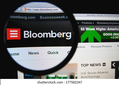 LISBON, PORTUGAL - FEBRUARY 19, 2014: Photo of Bloomberg homepage on a monitor screen through a magnifying glass. Bloomberg L.P. is a privately held financial software, data and media company.