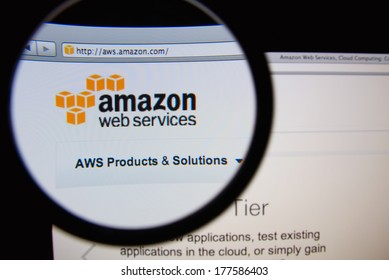 LISBON, PORTUGAL - FEBRUARY 19, 2014: Amazon Web Services homepage through a magnifying glass. AWS is a collection of web services that together make up a cloud computing platform.