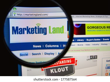 LISBON, PORTUGAL - FEBRUARY 19, 2014: Photo of Marketing Land homepage on a monitor screen through a magnifying glass. Marketing Land provides internet marketing news and analysis.
