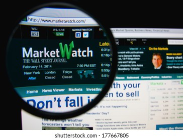 LISBON, PORTUGAL - FEBRUARY 19, 2014: Photo of MarketWatch homepage on a monitor screen through a magnifying glass. MarketWatch provides business news, analysis, and stock market data.