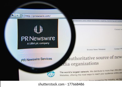 LISBON, PORTUGAL - FEBRUARY 19, 2014: Photo of PR Newswire homepage on a monitor screen through a magnifying glass.