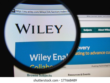 LISBON, PORTUGAL - FEBRUARY 19, 2014: Wiley homepage on a monitor screen through a magnifying glass. John Wiley & Sons, Inc. is a global publishing company that specializes in academic publishing.
