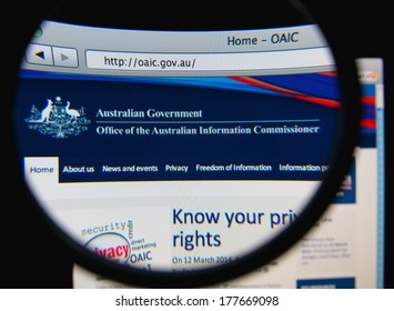 LISBON, PORTUGAL - FEBRUARY 19, 2014: The Office of the Australian Information Commissioner (OAIC) homepage through a magnifying glass.