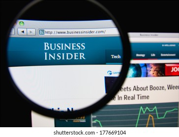 LISBON, PORTUGAL - FEBRUARY 19, 2014: Photo of Business Insider homepage on a monitor screen through a magnifying glass. Business Insider is a US business and technology news website.