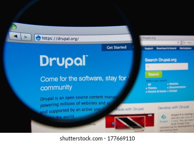 LISBON, PORTUGAL - FEBRUARY 19, 2014: Drupal website through a magnifying glass. Drupal is an open-source content management framework written in PHP, distributed under the GNU General Public License.