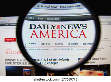 LISBON, PORTUGAL - FEBRUARY 19, 2014: Photo of the Daily News homepage on a monitor screen through a magnifying glass. The Daily News is an American newspaper based in New York City.
