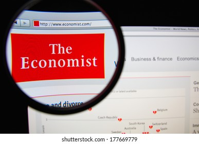 LISBON, PORTUGAL - FEBRUARY 19, 2014: Photo of The Economist homepage on a monitor screen through a magnifying glass. The Economist is an English-language weekly newspaper.
