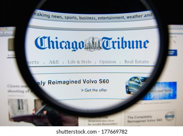 LISBON, PORTUGAL - FEBRUARY 19, 2014: Photo of the Chicago Tribune homepage on a monitor screen through a magnifying glass. The Chicago Tribune is a major daily newspaper.