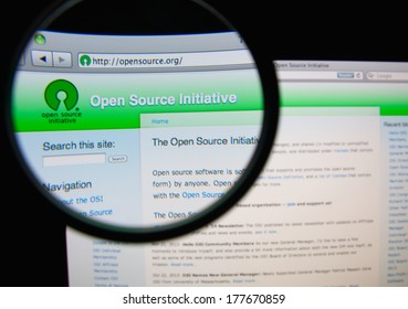 LISBON, PORTUGAL - FEBRUARY 19, 2014: Photo of the Open Source Initiative homepage on a monitor screen through a magnifying glass. OSI is an organization dedicated to promoting open-source software.