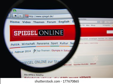 LISBON, PORTUGAL - FEBRUARY 19, 2014: Photo of Spiegel Online homepage on a monitor screen through a magnifying glass. SPON is the online sibling of Germany's print weekly Der Spiegel.