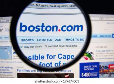 LISBON, PORTUGAL - FEBRUARY 19, 2014: Photo of Boston.com homepage on a monitor screen through a magnifying glass. Boston.com is a website that offers news and information about the Boston area.