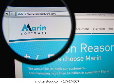 LISBON, PORTUGAL - FEBRUARY 19, 2014: Photo of Marin Software homepage on a monitor screen through a magnifying glass.
