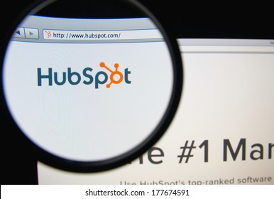 LISBON, PORTUGAL - FEBRUARY 19, 2014: Photo of HubSpot homepage on a monitor screen through a magnifying glass. HubSpot develops and markets a software-as-a-service product for inbound marketing.