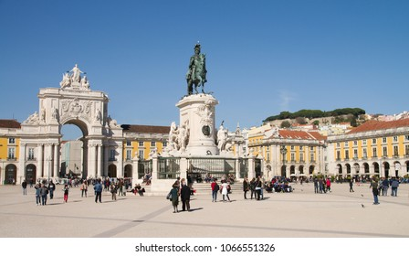 LISBON, PORTUGAL - FEBRUARY 20: Terreiro do Paco, also known as Praca do Comercio, on February 20, 2018 in Lisbon. King D. Jose statue, Rua Augusta Arch and the castle hill in background.
