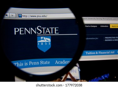 LISBON, PORTUGAL - FEBRUARY 21, 2014: Photo of Penn State homepage on a monitor screen through a magnifying glass.
