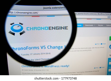 LISBON, PORTUGAL - FEBRUARY 21, 2014: Photo of ChronoEngine homepage on a monitor screen through a magnifying glass.