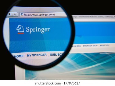 LISBON, PORTUGAL - FEBRUARY 21, 2014: Photo of Springer homepage on a monitor screen through a magnifying glass. Springer Science+Business Media is a global publishing company.