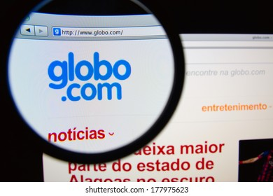LISBON, PORTUGAL - FEBRUARY 21, 2014: Photo of Globo homepage on a monitor screen through a magnifying glass. Globo is the largest mass media group of Latin America.