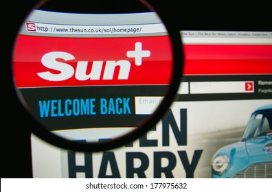 LISBON, PORTUGAL - FEBRUARY 21, 2014: Photo of the SUN homepage on a monitor screen through a magnifying glass. The Sun is a daily tabloid newspaper published in the United Kingdom and Ireland.