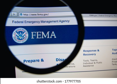 LISBON, PORTUGAL - FEBRUARY 21, 2014: Photo of Federal Emergency Management Agency homepage on a monitor screen through a magnifying glass. FEMA is an agency of the US Department of Homeland Security.