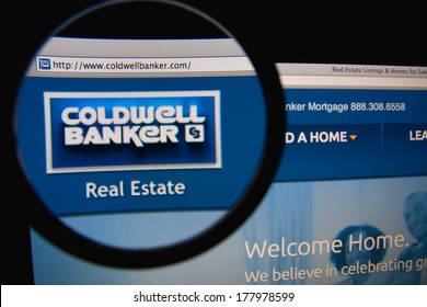 LISBON, PORTUGAL - FEBRUARY 21, 2014: Photo of Coldwell Banker homepage on a monitor screen through a magnifying glass. Coldwell Banker Real Estate LLC is an American real estate franchise.