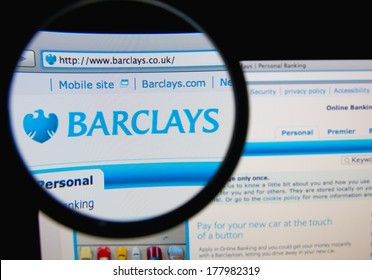 LISBON, PORTUGAL - FEBRUARY 21, 2014: Photo of Barclays homepage on a monitor screen through a magnifying glass.