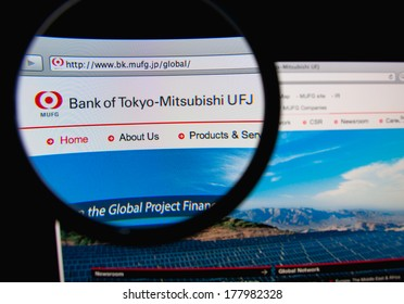 LISBON, PORTUGAL - FEBRUARY 21, 2014: Photo of the Bank of Tokyo-Mitsubishi UFJ homepage on a monitor screen through a magnifying glass.
