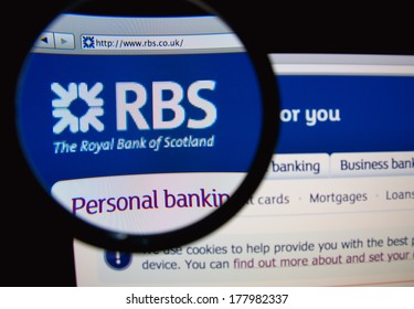 LISBON, PORTUGAL - FEBRUARY 21, 2014: Photo of the Royal Bank of Scotland homepage on a monitor screen through a magnifying glass.