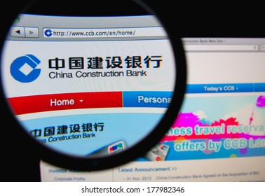 LISBON, PORTUGAL - FEBRUARY 21, 2014: Photo of the China Construction Bank homepage on a monitor screen through a magnifying glass.
