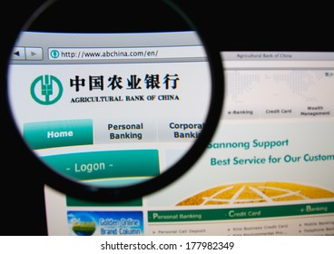 LISBON, PORTUGAL - FEBRUARY 21, 2014: Photo of Agricultural Bank of China homepage on a monitor screen through a magnifying glass.