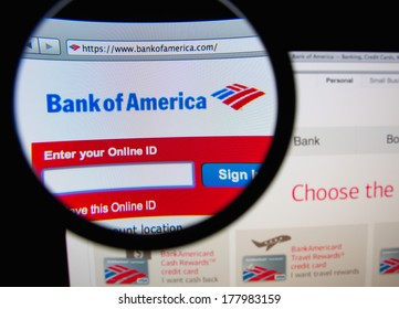 LISBON, PORTUGAL - FEBRUARY 21, 2014: Photo of Bank of America homepage on a monitor screen through a magnifying glass.