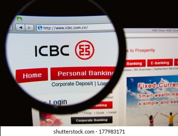 LISBON, PORTUGAL - FEBRUARY 21, 2014: Photo of the Industrial and Commercial Bank of China homepage on a monitor screen through a magnifying glass.