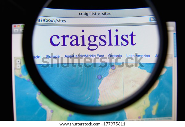 LISBON, PORTUGAL - FEBRUARY 21, 2014: Photo of Craigslist homepage on a monitor screen through a magnifying glass. Craigslist is a classified advertisements website.