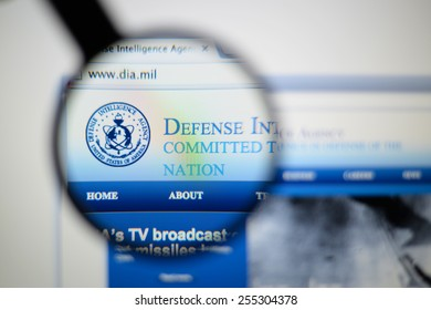 LISBON, PORTUGAL - February 24, 2015: Photo of DEFENSE INTELLIGENCE AGENCY page on a monitor screen through a magnifying glass.