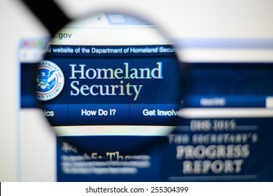 LISBON, PORTUGAL - February 24, 2015: Photo of The Department of Homeland Security page on a monitor screen through a magnifying glass.